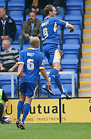Photo: Steve Bond.<br /> Shrewsbury Town v Chesterfield. Coca Cola League 2. 13/10/2007. Dave Hibbert (upper) celebrates