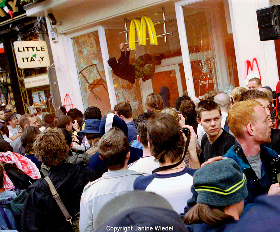 McDonald's being vandalised during the Mayday 2000  anti capitalist protests, Whitehall  London.