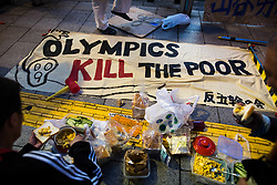 "June 30, 2017 - Shinjuku, Tokyo, Japan - Anti-Olympic protesters were seen eating with a signs on the ground that reads ''Olympics Kill the Poor"" during a protest against hosting the Tokyo Olympic Games 2020 on Friday, June 30, 2017, downtown, Shinjuku, Japan. The protesters asked the Japanese government to use the Olympics funds for social spending and Olympic money would be better spent alleviating poverty. (Credit Image: © Richard Atrero De Guzman/NurPhoto via ZUMA Press)"