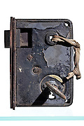studio still life of an old rusty door lock with key
