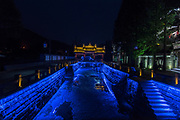 Night view of the ancient Chinese gate at Qintai Road historic district, Chengdu, Sichuan, China