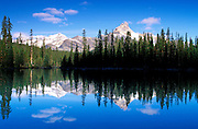 Morning light on Cathedral Peak reflected in Lake O'Hara, Yoho National Park, British Columbia, Canada.