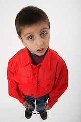 Portrait of young boy standing,