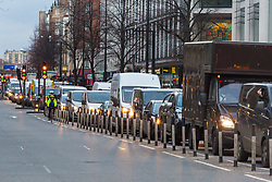 PICTURED: A traffic tailback on Edgeware road develops as anti pollution protesters block traffic at Marble Arch. Demonstrators from the anti-pollution group Stop Killing Londoners cause traffic chaos for London commuters as they conduct a series of short roadblocks at Marble Arch stopping cars and buses from entering Oxford Street and Park Lane. Irate motorists accused them of creating more pollution than they were stopping, whilst the group said their objectives were long term. A leaflet handed out to motorists says the government is not doing enough to tackle the crisis costing 'taxpayers and the NHS £billions [sic] a year'. PLACE, January 29 2018. © Paul Davey