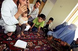 KABUL 04 August 2005..Khair-Khana, Panza Family...Shaid Nafus, a local resident, describes Shabana's desease to  an UNFPA Employee in Kabul  over the phone...