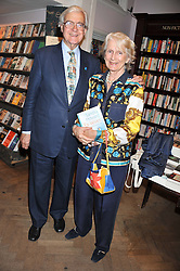 LORD & LADY BAKER OF DORKING at a party to celebrate the publication of Sandra Howard's new book - Ex-Wives held at Daunt Books, 83 Marylebone High Street, London W1 on 30th April 2012.
