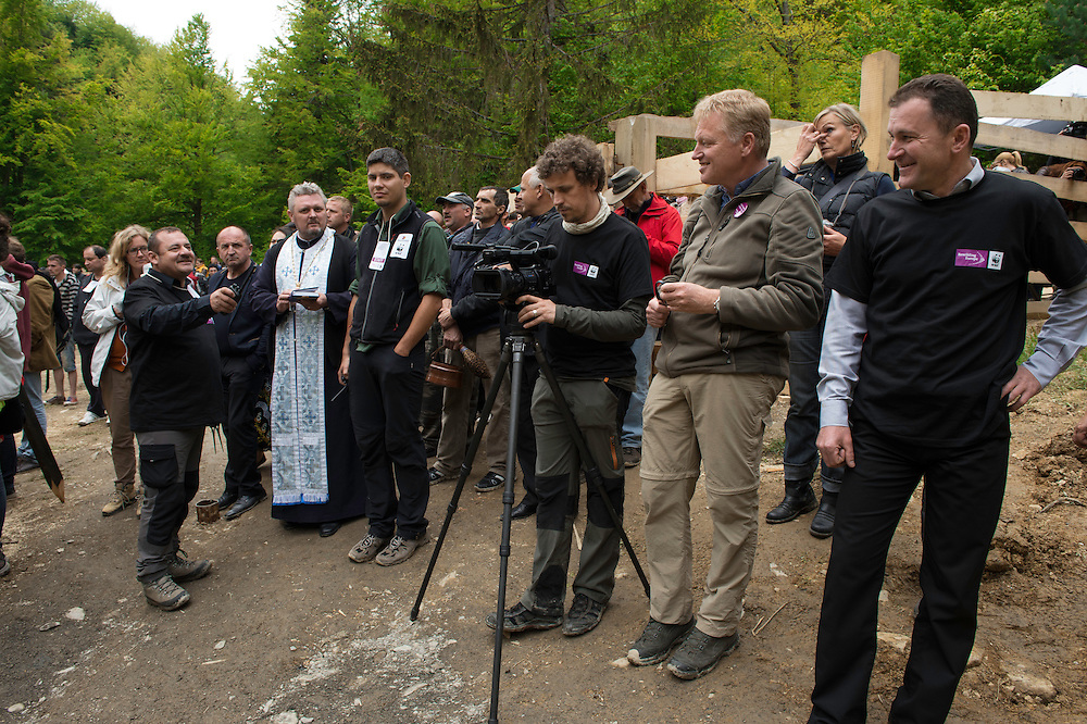 The Rewilding team, the Armenis priest and Armenis Mayot Petru Vela, at the release of European bison, Bison bonasus, in the Tarcu mountains nature reserve, Natura 2000 area, Southern Carpathians, Romania. The release was actioned by Rewilding Europe and WWF Romania in May 2014.