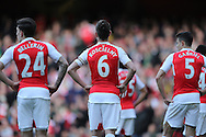 Héctor Bellerín of Arsenal, Laurent Koscielny of Arsenal and Gabriel of Arsenal look on. Barclays Premier league match, Arsenal v Crystal Palace at the Emirates Stadium in London on Sunday 17th April 2016.<br /> pic by John Patrick Fletcher, Andrew Orchard sports photography.