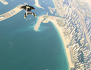 Bird Man swoops over Dubai's Iconic Coastline<br /> <br /> Thousands of feet above the ground, the air rushing in through the plane's open door is bitterly cold. The wind blasts around the small cabin, making Richard Schneider's wingsuit rustle wildly. Yet Schneider doesn't cower in fright at what will soon happen. Not a bit of it – even if a nervous excitement fills him as he edges toward the door of the airplane.<br /> Once at the exit, Schneider takes in the dizzying view: the wispy clouds around him, the swirling land formations and sprawling cityscape below, and nothing but air in between. He steps out of the plane's door and, spreading his arms and legs wide – a bird on manmade wings – begins his flight over arguably the most opulent and extravagant city in the world.<br /> Once at the exit, Schneider takes in the dizzying view: the wispy clouds around him, the swirling land formations and sprawling cityscape below, and nothing but air in between. He steps out of the plane's door and, spreading his arms and legs wide – a bird on manmade wings – begins his flight over arguably the most opulent and extravagant city in the world.<br /> ©Richard Schneider/Exclusivepix Media