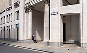 A man sits to enjoy a cup of coffee in the sunshine on the corner of Ave Maria Lane near St Pauls Cathedral on the 25th of May 2021 in central London, United Kingdom. Ave Maria Lane is a small street in the City of London, to the west of St. Pauls Cathedral. It is the southern extension of Warwick Lane, between Amen Corner and Ludgate Hill. On the feast day of Corpus Christi, monks would say prayers in a procession to St. Pauls Cathedral.