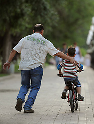 File photo dated 20/06/12 of a boy learning to ride a bike. Restrictions on benefit payments to families with more than two children have been relaxed, with a new exemption covering all of those who are adopted or taken in by relatives other than their parents.