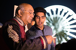 "© Licensed to London News Pictures. 01/11/2015. Leicester, UK. More than 35,000 people were estimated to have attended the annual Diwali ight switch-on which took place along the named ""Golden Mile"" in Belgrave Road, Leicester. Pictured, Leicester MP Keith Vas, left,  welcomed Olympic boxer Vijender Singh who had stopped off on his way from Dheli to Ireland to be at the festival. Photo credit : Dave Warren/LNP"