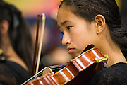 Sharlene Reyes, freshman, of Milpitas High School plays the viola during the Milpitas Unified School District's Tenth Annual Music Festival at Milpitas High School in Milpitas, California, on April 4, 2013. (Stan Olszewski/SOSKIphoto)