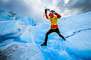 Expedition racer Thomas Bastis of Team NorCal (USA) leaps an ice river on Glacier Tyndall in Chilean Patagonia, on February 12, 2013, during the 2013 Patagonian Expedition Race.