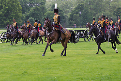 Hyde Park, London, June 2nd 2016. Soldiers and guns of the King's Troop Royal Horse Artillery fire a 41 round Royal Salute to mark the 63rd anniversary of the coronation of Britain's Monarch HM Queen Elizabeth II. PICTURED: The hooves thunder across the grass as the gun carriages arrive.