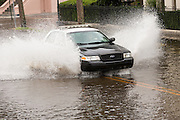 A police car patrols through floodwater along the Battery in the historic district after record breaking storms dumped more than two feet of rain on the lowcountry October 5, 2015 in Charleston, South Carolina.