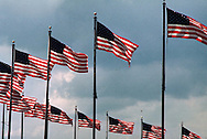 A 27.8 MG FILE FROM FILM OF:.American Flags fly at the base of the Washington Monument in Washington, DC. Photo by Dennis Brack