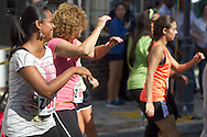 Middletown, New York - People follow instructors from Studio Ayo during Zumba in the Street at the Run 4 Downtown road race on Aug. 18, 2012.