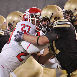 Oct 23, 2009; West Point, N.Y., USA; Rutgers cornerback Wayne Warren (27) is blocked on a punt return during Rutgers' 27 - 10 victory over Army at Michie Stadium.