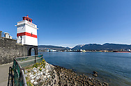 Brockton Point Lighthouse and the Stanley Park Seawall at Brockton Point in Stanley Park, Vancouver, British Columbia, Canada