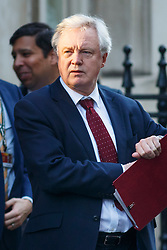 © Licensed to London News Pictures. 24/01/2017. London, UK. Secretary of State for Exiting the European Union DAVID DAVIS leaves Downing Street to attend House of Commons following the government's defeat in the Supreme Court ruling that formal process for the UK to leave the European Union, cannot be triggered without a vote in Parliament. Photo credit: Tolga Akmen/LNP
