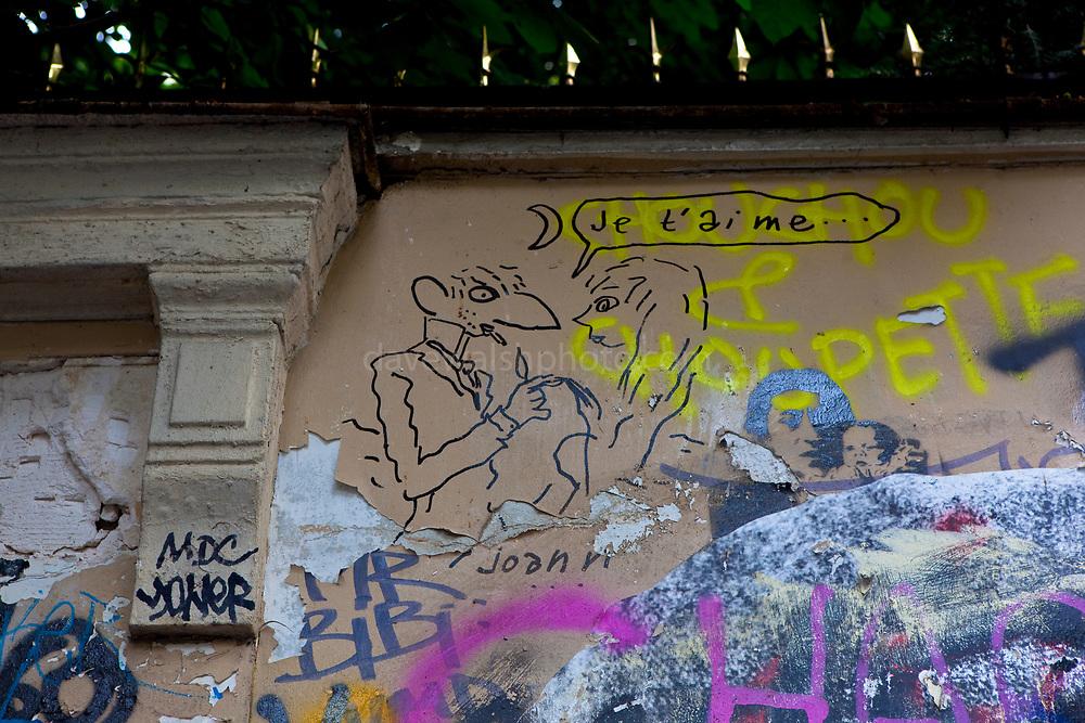 Grafitti by Joann Sfar on exterior of house of Serge Gainsbourg, 5 Bis Rue de Verneuil, 75006 Paris, France.  La maison de Serge Gainsbourg.