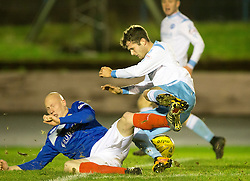 Cowdenbeath's Craig Johnston and Forfar Athletic's Danny Denholm. Cowdenbeath 3 v 4 Forfar Athletic, Scottish Football League Division Two game played 17/12/2016 at Central Park.