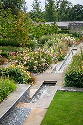 Rill in the walled garden at Wynyard Hall with Rosa 'Port Sunlight' syn. 'Auslofty' and Rosa 'Molineux' syn. 'Ausmol'