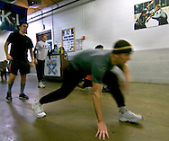 1/5/07 -- Omaha, NE<br />  -- USHL OMaha Lancer Nick Petrecki stretches in the concourse with the team before the game against the LIncoln Stars. <br /> Photo by Chris Machian, Prairie Pixel Group