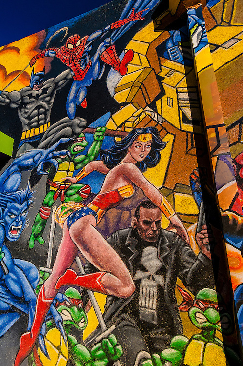 """Mural of comic book super heroes on the side of """"Masks Y Mas"""" store, Albuquerque, New Mexico USA"""