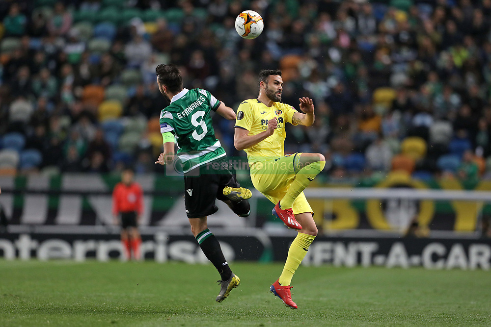 February 14, 2019 - Lisbon, Portugal - Bruno Fernandes of Sporting CP (L) vies for the ball with Vicente Iborra of Villarreal FC (R) during the Europa League 2018/2019 footballl match between Sporting CP vs Villarreal FC. (Credit Image: © David Martins/SOPA Images via ZUMA Wire)