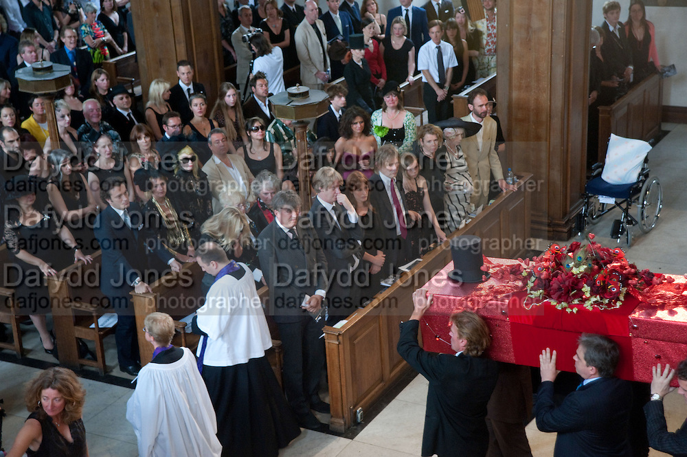COFFIN LEAVING CHURCH; STEPHEN FRY AND VALERIE WALMSLEY HUNTER AMONGST CONGREGATION, Sebastian Horsley funeral. St. James's church. St. James. London afterwards in the church garden. July 1 2010. -DO NOT ARCHIVE-© Copyright Photograph by Dafydd Jones. 248 Clapham Rd. London SW9 0PZ. Tel 0207 820 0771. www.dafjones.com.