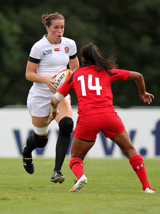 Emily Scarratt in action. England v Canada Pool A match at WRWC 2014 at Centre National de Rugby, Marcoussis, France, on 9th August 2014