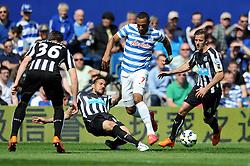 Newcastle United's Jonas Gutierrez tackles Queens Park Rangers' Matt Phillips - Photo mandatory by-line: Dougie Allward/JMP - Mobile: 07966 386802 - 16/05/2015 - SPORT - football - London - Loftus Road - QPR v Newcastle United - Barclays Premier League