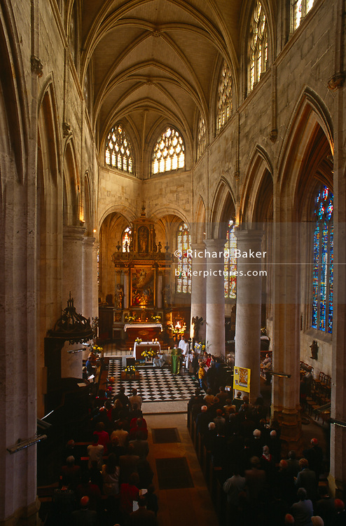 Aerial view of Mass being held in a local rural Catholic church, on 15th October 1997, in Neubourg, Normandy, France