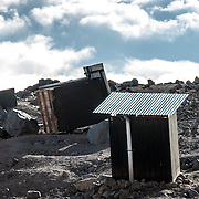 Wooden outhouses battered and blown over by gale force winds at Arrow Glacier Camp on Mt Kilimanjaro's Lemosho Route.