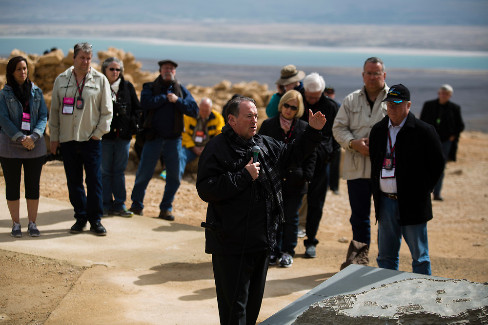 Former Arkansas governor Mike Huckabee, is seen as he delivers a speech to a group of American Evangelical Christian tourists and pilgrims led by him, during a visit to the ancient hilltop fortress of Masada in the Judean desert in Israel, on February 19, 2015. The ancient ruined desert fortress on a wind-swept plateau overlooking the Dead Sea is seen by many as an emblem of Israel's fighting spirit, it is believed to be the place where close to a thousand Jewish rebels killed themselves and each other about two millennia ago, rather than surrender and fall into slavery under the Romans.