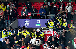 File photo dated 12-10-2021 of Hungary fans clash with police officers in the stands during the FIFA World Cup Qualifying match at Wembley Stadium, London. FIFA has condemned the disturbances which marred England's World Cup qualifier against Hungary on Tuesday night, and the violent scenes at the Albania v Poland match in the same group. Issue date: Wednesday October 13, 2021.