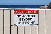 Sydney, Australia. Saturday 18th April 2020.Tamarama Beach in Sydney's eastern suburbs closed due to the Coronavirus Pandemic. From yesterday Tamarama beach was reopened for swimming and surfing. Waverley council sign saying No Access.