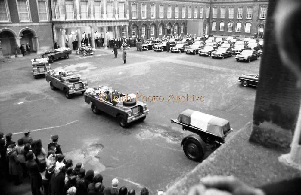 Funeral of President Childers.    (H62)..1974..20.11.1974..11.20.1974..20th November 1974..Following a period of lying in state, the remains of President Erskine Childers were removed today from Dublin Castle. The cortege would transfer the president to St Patrick's Cathedral where the funeral service would be held...Picture of the cortege, carrying the body of the late President Childers, moving towards the gates of Dublin Castle and out onto Dublin's streets where the people were waiting to pay their respects.