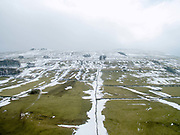 An aerial view of a Wensleydale hillside thawing after a particularly heavy snow storm in North Yorkshire, UK on 5th March 2018. Wensleydale is the dale or upper valley of the River Ure, one of the Yorkshire Dales