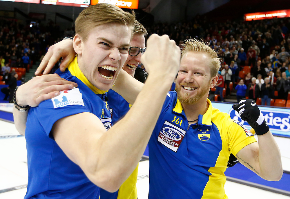Sweden skip Niklas Edin celebrates winning with teammates Christoffer Sundgren (L) and Kristian Lindstrom (C) after they defeated Norway to win gold medal match at the World Men's Curling Championships in Halifax, Nova Scotia, April 5, 2015.    REUTERS/Mark Blinch