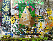 Street art painting in old mill building in Vernonia, Oregon depicting tri-colored pyramid with human features
