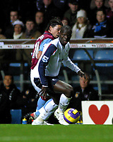 Photo: Dave Linney.<br />Aston Villa v Bolton Wanderers. The Barclays Premiership. 16/12/2006.Bolton's  Abdoulaye  Faye(R) keeps calm under pressure from  Milan Baros.