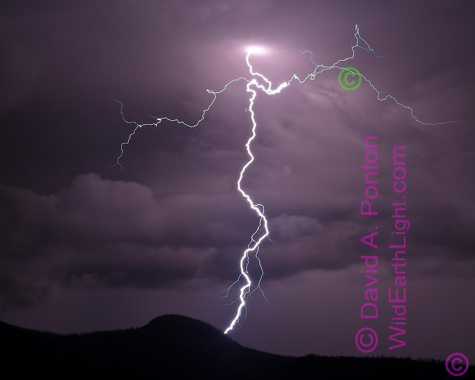 Cloud-to-ground lightning over  Redondito Peak in the Valles Caldera National Preserve, © David A. Ponton