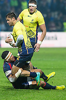 Folau Niau (L) of USA tries to stop Adrian Apostol (C) of Romania during their  rugby test match between Romania and USA, on National Stadium Arc de Triomphe in Bucharest, November 8, 2014.  Romania lose the match against USA, final score 17-27.