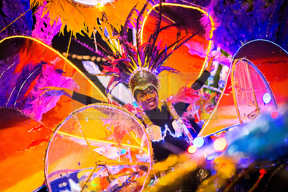 © Licensed to London News Pictures. 05/10/2017. Leeds UK. Leeds West Indian Carnival performers dance through Leeds city centre for the Leeds Light Night Carnival on the first night of the Leeds Light Night event which runs until 6th October. Light Night is an annual free multi arts festival that takes place every October in Leeds City centre, starting in 2005, the event has grown and is now enjoyed by 80,000 people. Photo credit: Andrew McCaren/LNP