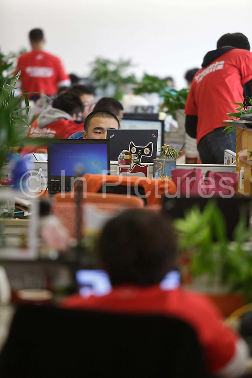 T Mall employees man their work stations during the November 11 shopping festival at Alibaba's head quarters in Hangzhou , China on 11 November 2013. Alibaba, the parent company of T Mall, recorded $5.78 billion of sales during this Chinese version of Black Friday in 2013, as people in China increasingly log on to their computers to shop.