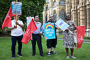 Unite members holding placards and flags prepare to march with NHS workers from the grassroots NHSPay15 campaign from opposite Parliament to 10 Downing Street with a petition signed by over 800,000 people calling for a 15% pay rise for NHS workers on 20th July 2021 in London, United Kingdom. At the time of presentation of the petition, the government was believed to be preparing to offer NHS workers a 3% pay rise in recognition of the unique impact of the pandemic on the NHS.