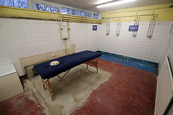 A general view of the home dressing room shower area at Gander Green Lane, home of Sutton United Football Club in South London.